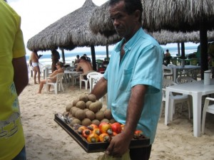 Cashew fruits and guavas on the beach.